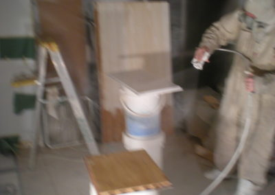 Tradesman Painting: Perry spraying Kitchen Cabinets in Spraybooth